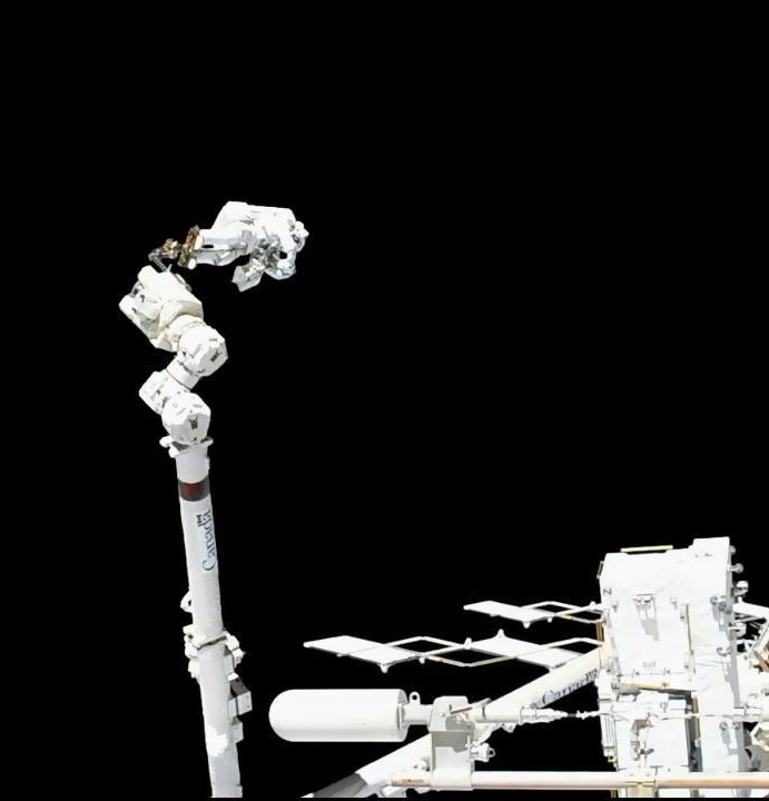 Spacewalkers Complete First Excursion to Repair Cosmic Particle Detector